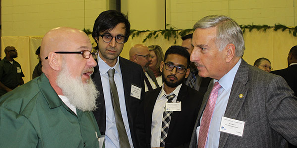 New York State Assemblyman David Weprin listening to a student