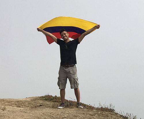 Peñuela holding up the Colombian Flag