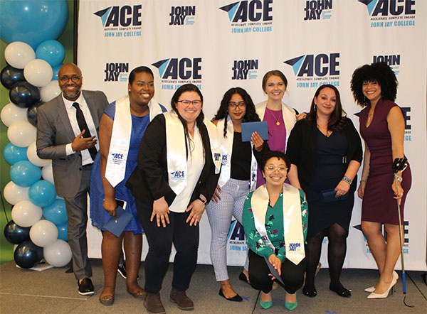 Ramirez (center) with members of the ACE program including ACE Director DeLandra Hunter (far left)
