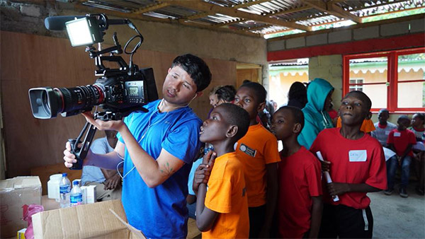 Rea teaching children in Haiti about filmmaking