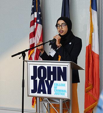 Lamia giving a speech