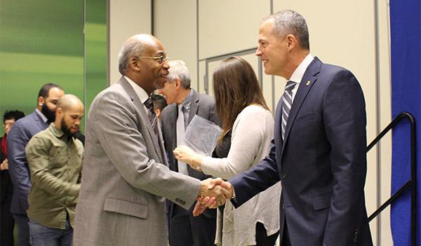 Anthony Sambula '20 shaking hands with Lt. Gen. Robert Ruark
