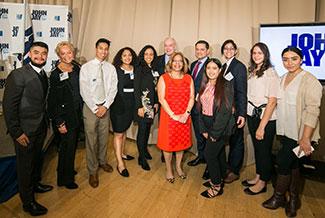 President Mason (center) with Rossana Rosado Fellows, Lynn Kroll (second from left), Jules Kroll (center, back), Professor José Luis Morín (center, right), and Program Coordinator Michelle López (far right)
