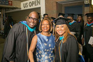 President Mason with 2018 John Jay graduate