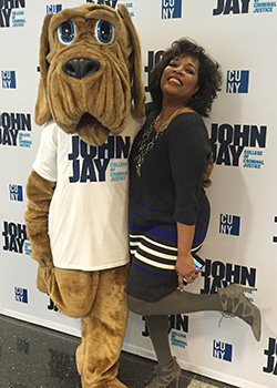 Lynette Cook-Francis, Vice President of Student Affairs, with John Jay College mascot The Bloodhound.