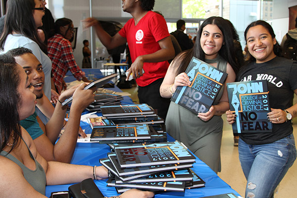 Students receiving their John Jay College yearbook
