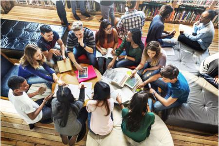 Students sitting in a circle discussing
