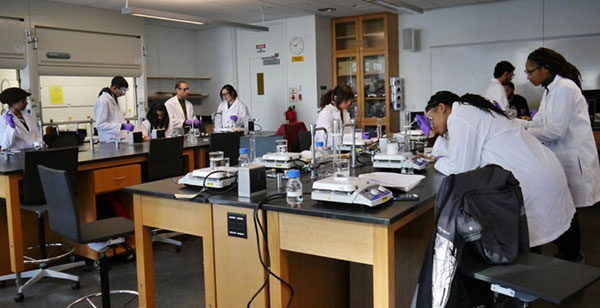 John Jay students in research lab