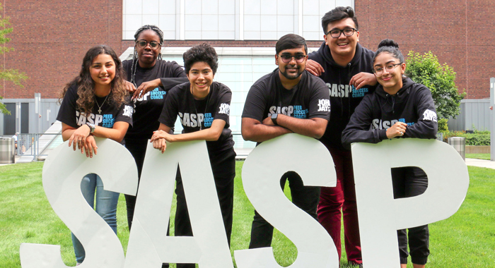 students standing behind the letters S-A-S-P