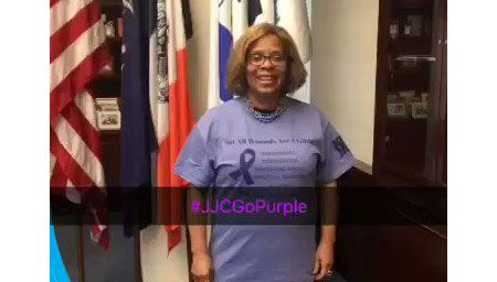 President Mason wearing purple T-shirt on National Domestic Violence Awareness Day