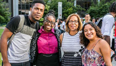 President Mason posing with John Jay students